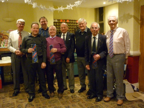 Choir members who received ties and certificates to commemorate over thirty and forty years singing in the Choir