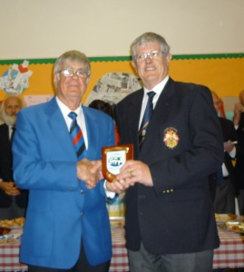 President Jim Evans presenting the president of Launceston MVC with a BMVC Shield to commemorate the Choir's visit May 2015