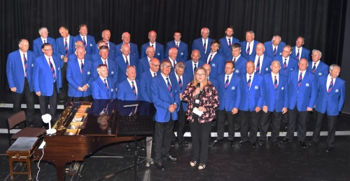 Helen Morris representing the Welsh Air Ambulance Service receiving a cheque in the sum £1,000 from Jim Evans, President of Builth Male Voice Choir.