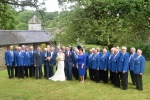 Bleddfa wedding – couple with choir in orchard(2)